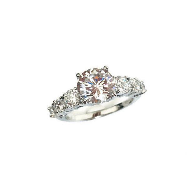 Solitaire Ring with tapered diamond simulants on band. sterling silver and white gold plating