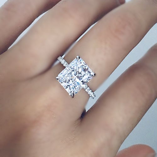 Radiant Cut Engagement Ring with Round Stones on band. Sterling Silver with white gold plating.